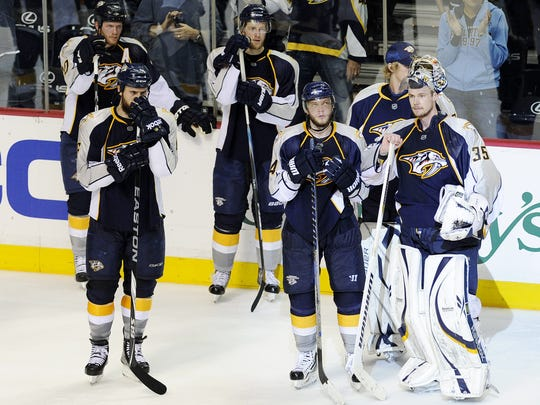 Dejected Predators players look on after being eliminated