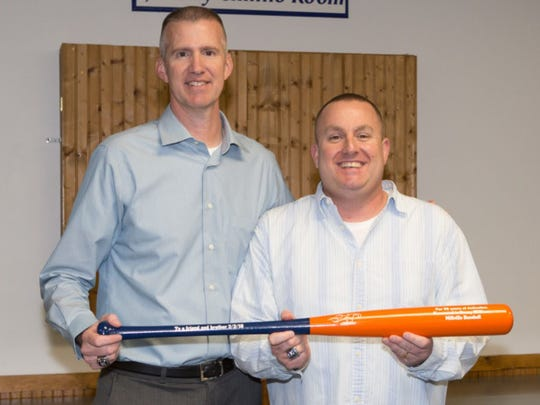 Millville head baseball coach Roy Hallenbeck, left, presents a bat to assistant Kenny Williams in February for 20 years of service.