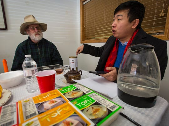Bob Rees, a 59-year-old Des Moines inventor, left, and Fei Zhou, the chief executive Iowa Food Manufacture, a tofu plant near Water Works Park in Des Moines Friday, Jan. 27, 2017.