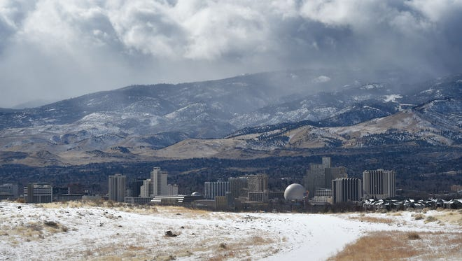 Fresh snow and storm clouds are seen in Reno on a snowy Thursday morning, Feb. 22, 2018.