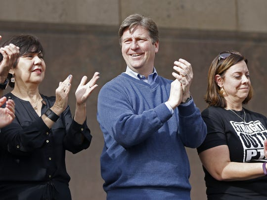 Phoenix Mayor Greg Stanton claps during Save Our Schools