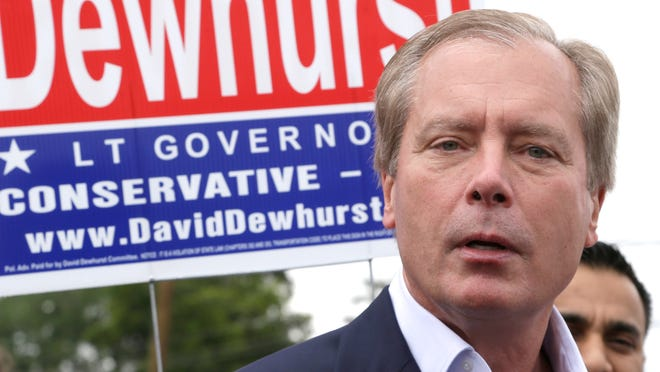 Texas Lt. Gov David Dewhurst faces the media at a polling place on election day Tuesday, May 27, 2014, in Houston. Dewhurst has been in a bitter Republican primary runoff against Dan Patrick. (AP Photo/Pat Sullivan) ORG XMIT: TXPS105