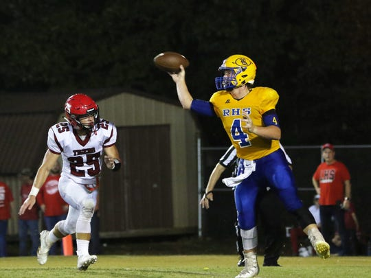 Riverside's Stone Frost (4) throws the ball against Lexington on Aug. 24, 2018.