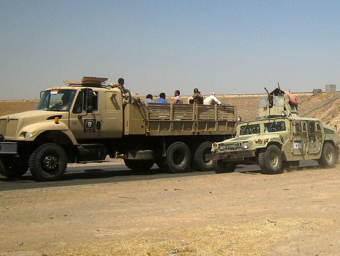 Iraqi security forces drive to Baghdad from Mosul.