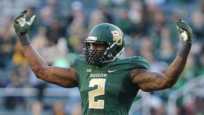 Baylor defensive end Shawn Oakman (2) fuels the fans in a NCAA college football game against Kansas, Saturday, Nov. 1, 2014, in Waco, Texas.