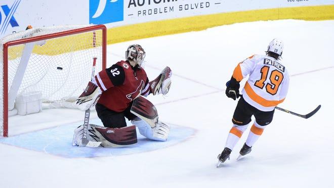 Feb 10, 2018; Glendale, AZ, USA; Philadelphia Flyers center Nolan Patrick (19) scores on Arizona Coyotes goalie Antti Raanta (32) during a shootout to win the game 4-3 at Gila River Arena. Mandatory Credit: Matt Kartozian-USA TODAY Sports
