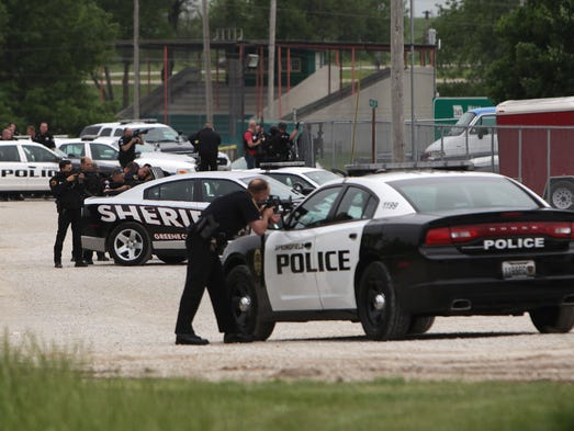 Springfield police and Greene County Sheriff's Deputies surround a storage facility in west Springfield, just after an armed woman was shot and killed on Tuesday, May 13, 2014.