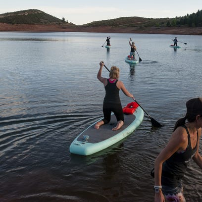 This summer, try stand-up paddleboarding at Horsetooth