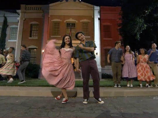 """Marko Germar, right, of Guam, performs in """"Grease:"""