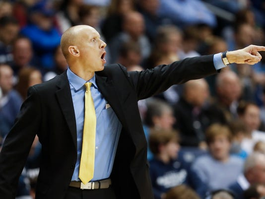 Xavier coach Chris Mack directs players during the second half of the team's NCAA college basketball game against DePaul, Wednesday, Feb. 8, 2017, in Cincinnati. Xavier won 72-61. (AP Photo/John Minchillo)