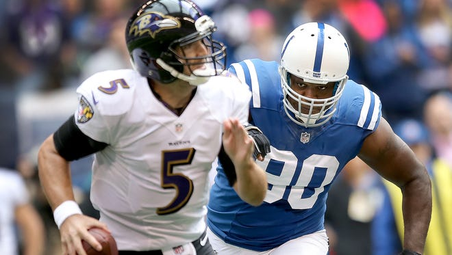 The Indianapolis Colts defeated the Baltimore Ravens 20-13 Sunday, October 5, 2014, afternoon at Lucas Oil Stadium. Here Indianapolis Colts Cory Redding runs down Baltimore Ravens Joe Flacco in the first half of their game.