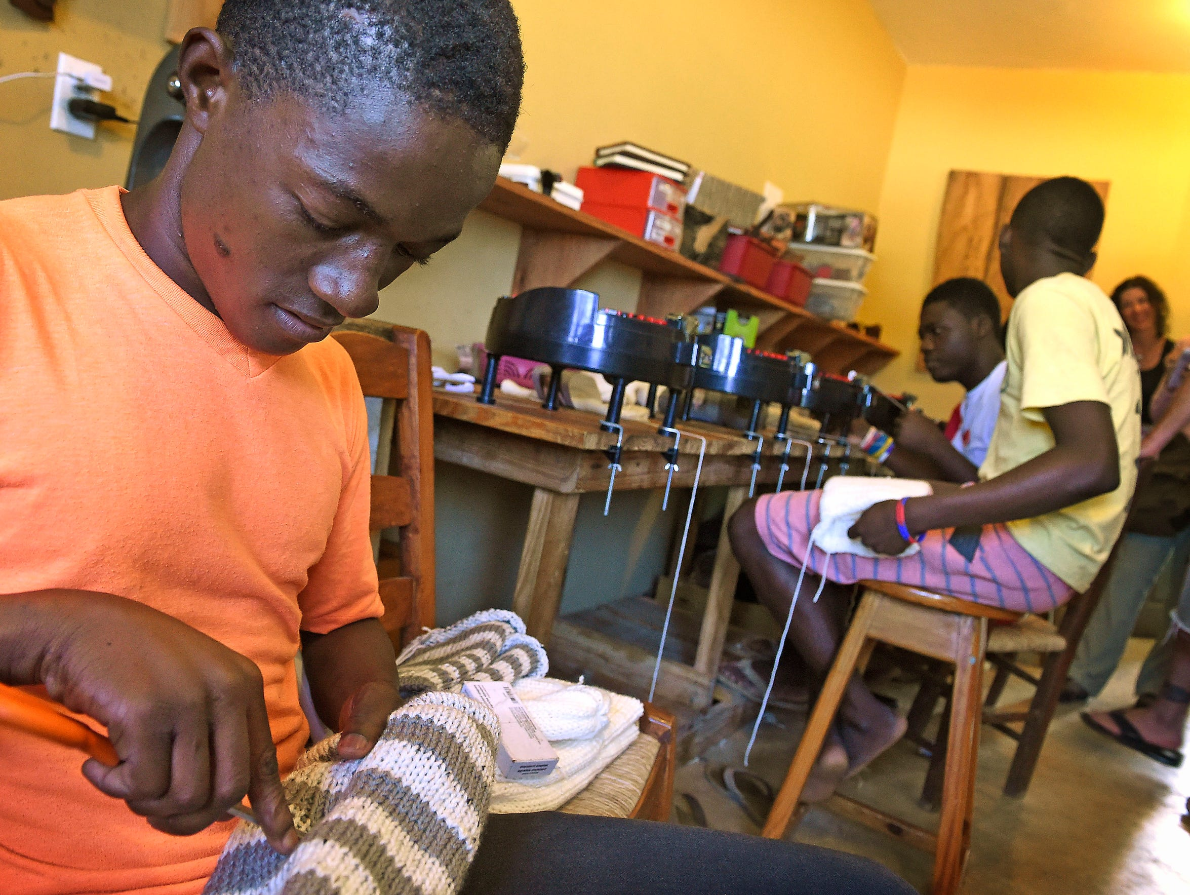 Local teenagers weave hats for the Haiti Made brand
