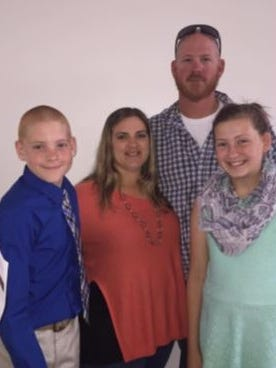 Nicole Lockwood Hunt, center, with her husband, Bob, and their two children.