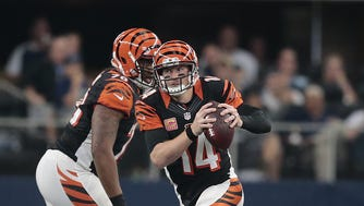 Bengals quarterback Andy Dalton scrambles out of the pocket as the offensive line blocks during an Oct. 9 loss to the Dallas Cowboys.