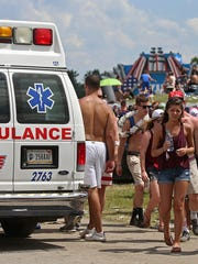 Several ambulances hauled people away from the Snake Pit during the 100th running of the Indianapolis 500, Indianapolis Motor Speedway, Sunday, May 29, 2016.