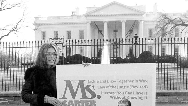 Gloria Steinem, publisher of the magazine Ms., holds a mock-up of that publication's January cover while standing in front of the White House, on Dec. 16, 1977. The issue rated President Carter's first year in office from a feminist perspective.