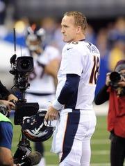 Denver Bronco quarterback Peyton Manning (18) stands