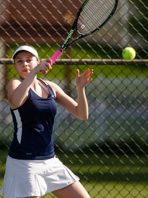 Hannah Vogelsang of Haslett volleys against Lakewood No. 1 singles junior Kendra Stoepker  May 19, 2016, during the Div. 3 Tennis Regional final at Haslett High School.   [MATTHEW DAE SMITH   for the Lansing State Journal]