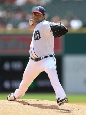Tigers Anibal Sanchez throws during the first inning of the Tigers' 7-4 win in Game 1 Saturday at Comerica Park.