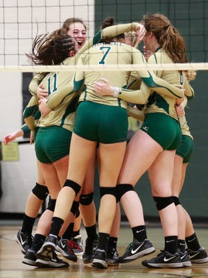 Howell celebrates a 3-0 victory over Hartland, the Highlanders' first in district volleyball since 2009.