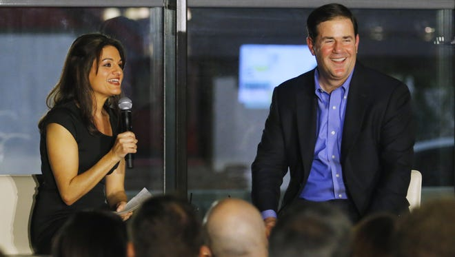 Gov. Doug Ducey takes part in a Q&A with Republic politics reporter Yvonne Wingett Sanchez at Mod Coworking Wednesday, Jan. 6, 2016, in Phoenix.