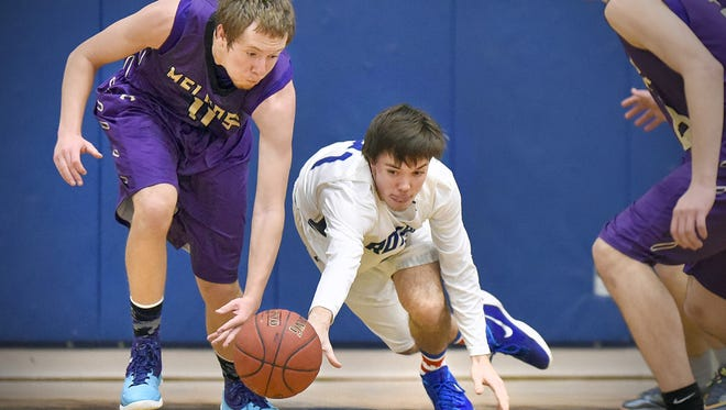 Melrose's Dillon Haider and Watertown-Mayer's Ben Ernhart dive for a loose ball during the second half of the Cathedral Christmas Classic Basketball Tournament last December. Haider is a returning senior starter for the Dutchmen.