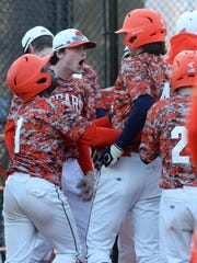 Briarcliff's celebrates Noah Campo (4) a home run during baseball game at Briarcliff High School April 18, 2018.  Briarcliff defeats Pleasantville 15-2.