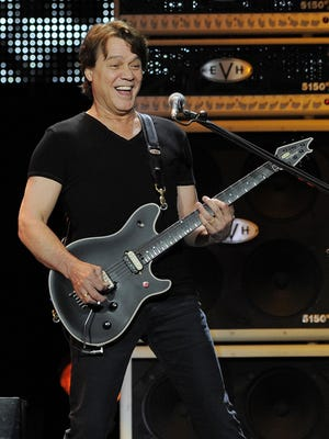 FILE - This June 1, 2012 file photo shows guitarist Eddie Van Halen of the band Van Halen performing in Los Angeles. Van Halen, who had battled cancer, died Tuesday, Oct. 6, 2020. He was 65.