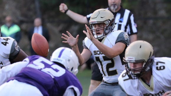Clarkstown South's quarterback Drew Tallevi takes the snap during the New Rochelle vs. Clarkstown South football game at Fosina Field in Flowers Park in New Rochelle, Sept. 8, 2017