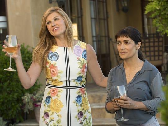 "Connie Britton (left) and Salma Hayek star in ""Beatriz at Dinner."""