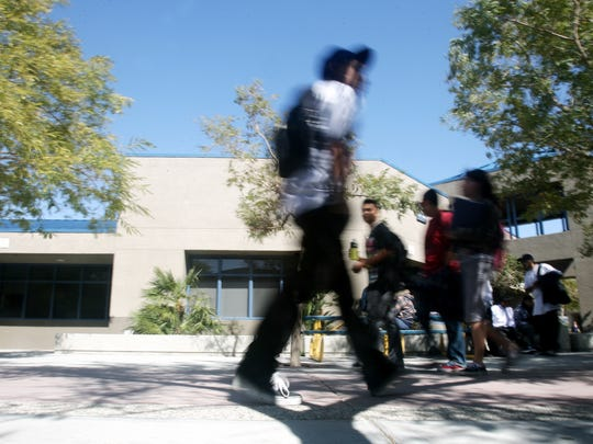 Students walk through campus at Desert Hot Springs High School on Monday, March 8, 2010 in Desert Hot Springs, Calif.