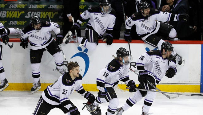 Minnesota State Mankato players celebrate after defeating Michigan Tech 5-2 to win the WCHA Final Five college championship hockey game in St. Paul on March 21.