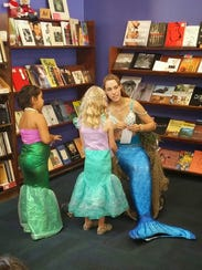 Mermaid Lyra reads to youngsters during the Return