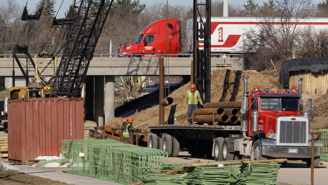 Some believe there is support for a .5 percent sales tax to fund road repairs throughout the county. A construction crew works on replacing the Interstate 43 bridge over county Highway O on March 30, 2011.