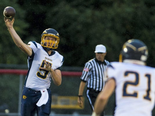 Elco quarterback Jeff Martin, who is nearing the Lebanon County career passing yardage record, has found a go-to receiver in first- year senior Andrew Olson (21).