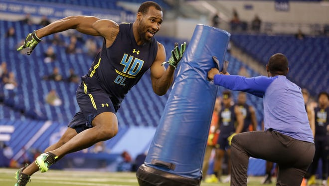 Temple defensive end Haason Reddick runs a drill at the NFL football scouting combine in Indianapolis, Sunday, March 5, 2017. (AP Photo/Michael Conroy)