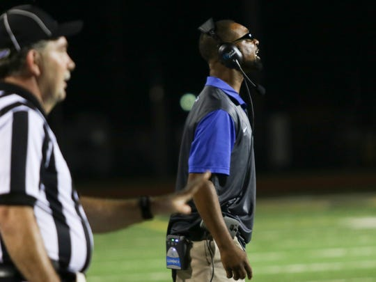 Fort Campbell High assistant coach Henry Mitchell yells from the sidelines during their game against Trigg County at Fryar Stadium on Friday. Fort Campbell won the game 35-14.
