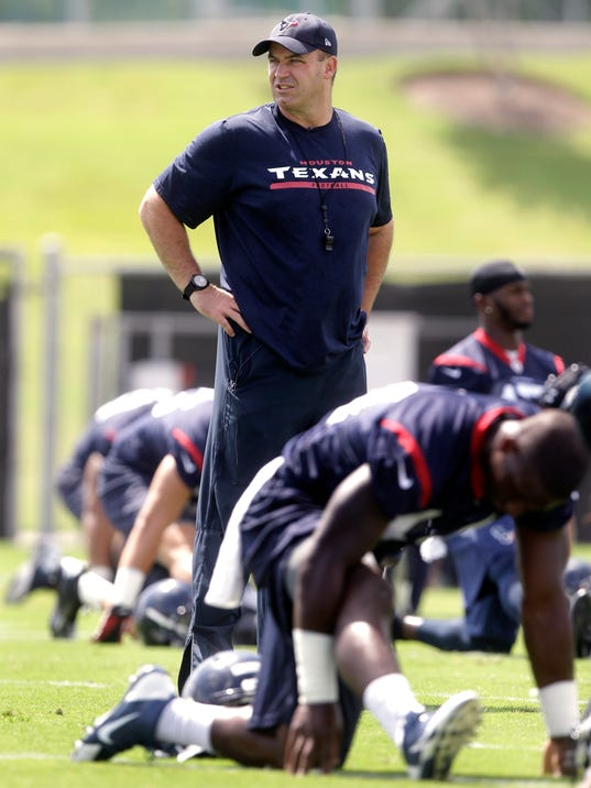 Houston Texans head coach Bill O'Brien watches his players stretch during NFL football minicamp, Tuesday, June 17, 2014, in Houston. (AP Photo/Patric Schneider)