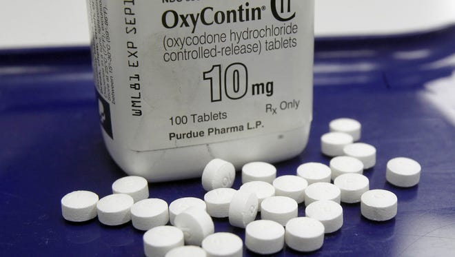 AP file photo  FDA advisers say risk plans should apply to all prescription painkillers,  not just long-acting drugs like OxyContin. FILE - This Feb. 19, 2013, file photo, shows OxyContin pills arranged for a photo at a pharmacy in Montpelier, Vt. Food and Drug Administration advisers are discussing changes to government programs that were intended to improve the safety of painkillers like OxyContin, but which have had an unclear impact. (AP Photo/Toby Talbot, File)