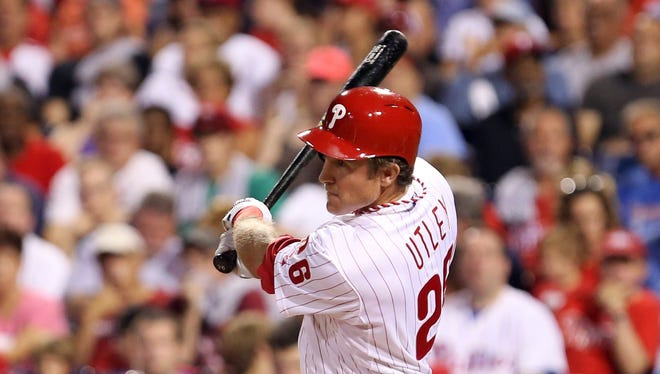 Philadelphia Phillies second baseman Chase Utley (26) singles to center during the first inning Wednesday against the Washington Nationals at Citizens Bank Park. Credit: Bill Streicher-USA TODAY Sports