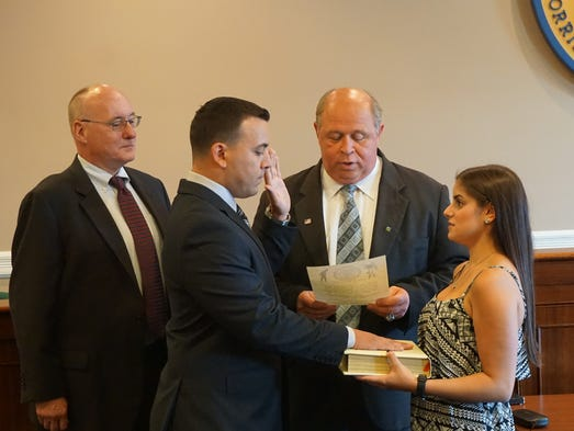 New Police Officer Pasquale Parisi is sworn in by Mayor James Barberio ...