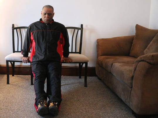 Stephen Lambert, 60, was without health insurance for 2 years before he was able to get health and dental insurance through the Affordable Care Act. Once his health insurance was gone, he made it a mission to eat healthier and exercise more. He is seen here doing dips in his Philadelphia Street home on Friday, Dec. 27, 2013. Jason Plotkin - Daily Record/Sunday News