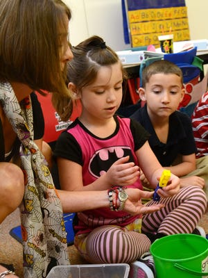 J. I. Barron Elementary kindergarten teacher Angie Todd teaches her students Kayleen Grooms, and Ruben Orosco, both 5, about place values using Eureka Math curriculum and manipulatives on Tuesday, October, 28, 2014. --Tia Owens-Powers/ towens@thetowntalk.com