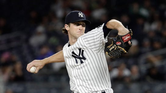 New York Yankees' Bryan Mitchell delivers a pitch during