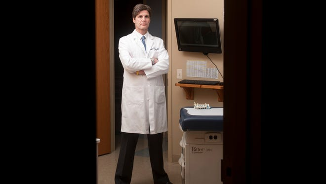 Dr. Laurence Fitzhenry, an anesthesiologist and pain management specialist for Premier Orthopedics, stands in an examination room in Mullica Hill.  04.07.16