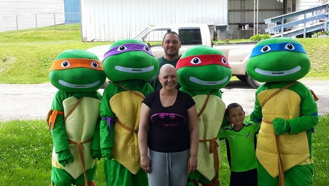 Beth Moran, center, was diagnosed with an aggressive and rare form of cervical cancer in February. A benefit will be held for Moran on Saturday featuring characters such as the Teenage Mutant Ninja Turtles. All proceeds will be donated to the family to help cover medical expenses.