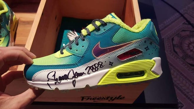 The Nike shoes Emory Maughan of Salem helped design with Nike, and autographed by Olympic gymnast Shawn Johnson, to raise money for Doernbecher Children's Hospital.