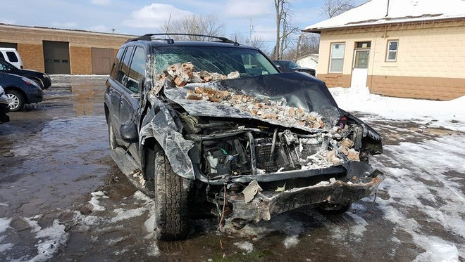 A sports utility vehicle crashed into Albion Elementary School Monday afternoon.