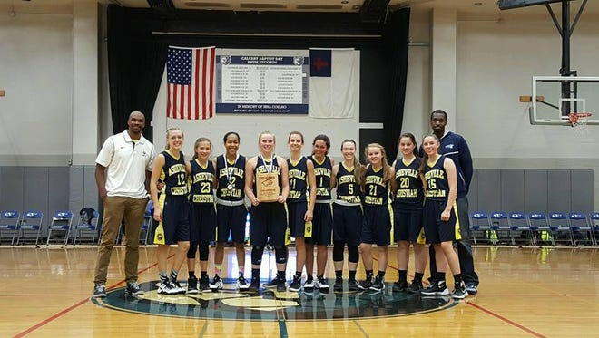 Former UNC Asheville standouts John Williams, far left, and Joey Harrell, far right, are coaching this season's Asheville Christian Academy girls basketball team.