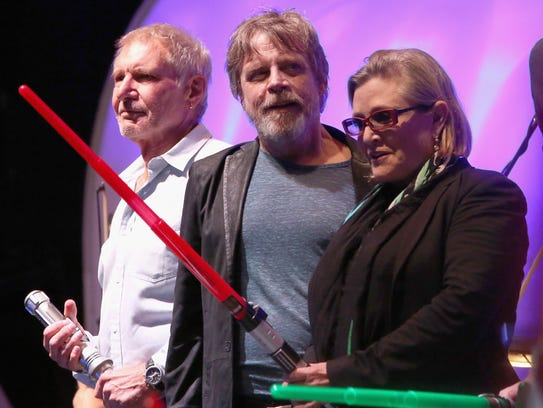 Harrison Ford (left), Mark Hamill and Carrie Fisher